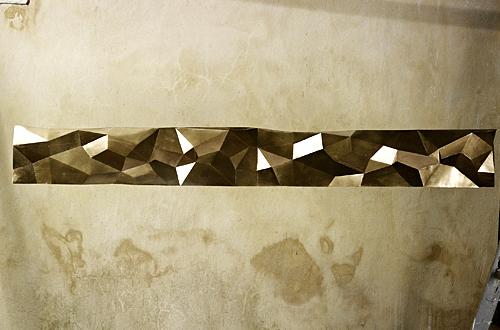 Incrustation de motif dans le mur