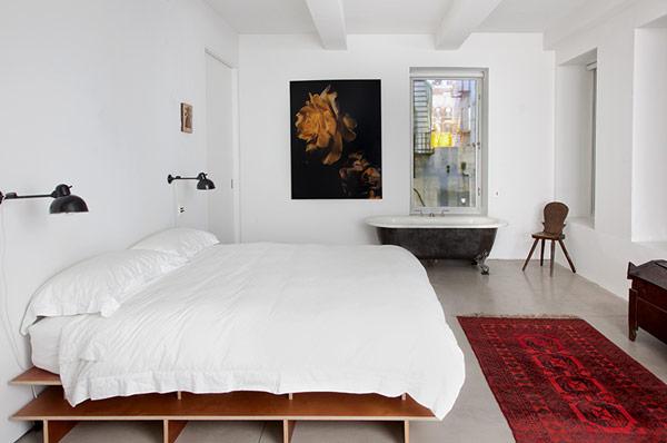Chambre cosy avec baignoire pattes de lion