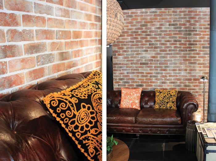 Chesterfield vintage et mur en briques rouges