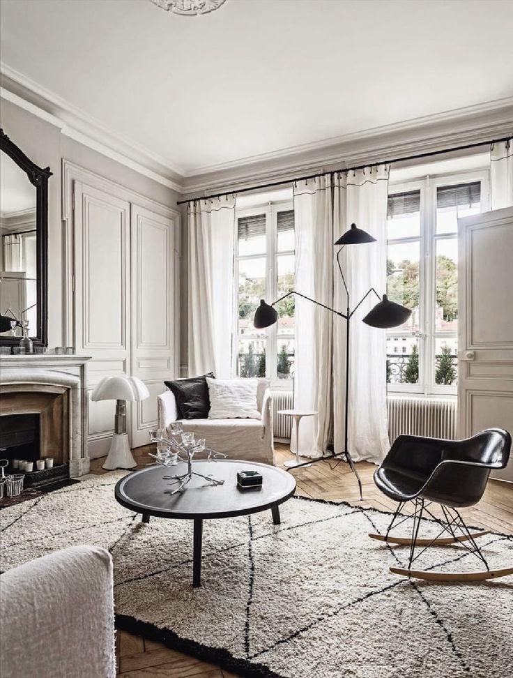 Luminaire Serge Mouille et fauteuil Eames