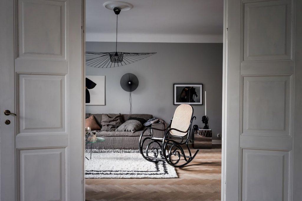 Décoration salon canapé gris et suspension Vertigo
