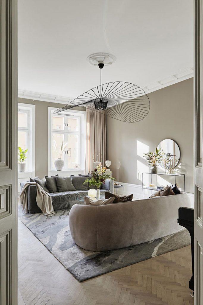 Déco salon avec canapé et suspension Vertigo